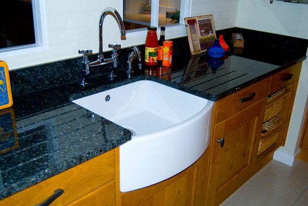 A Belfast sink - granite countertop - stonegate