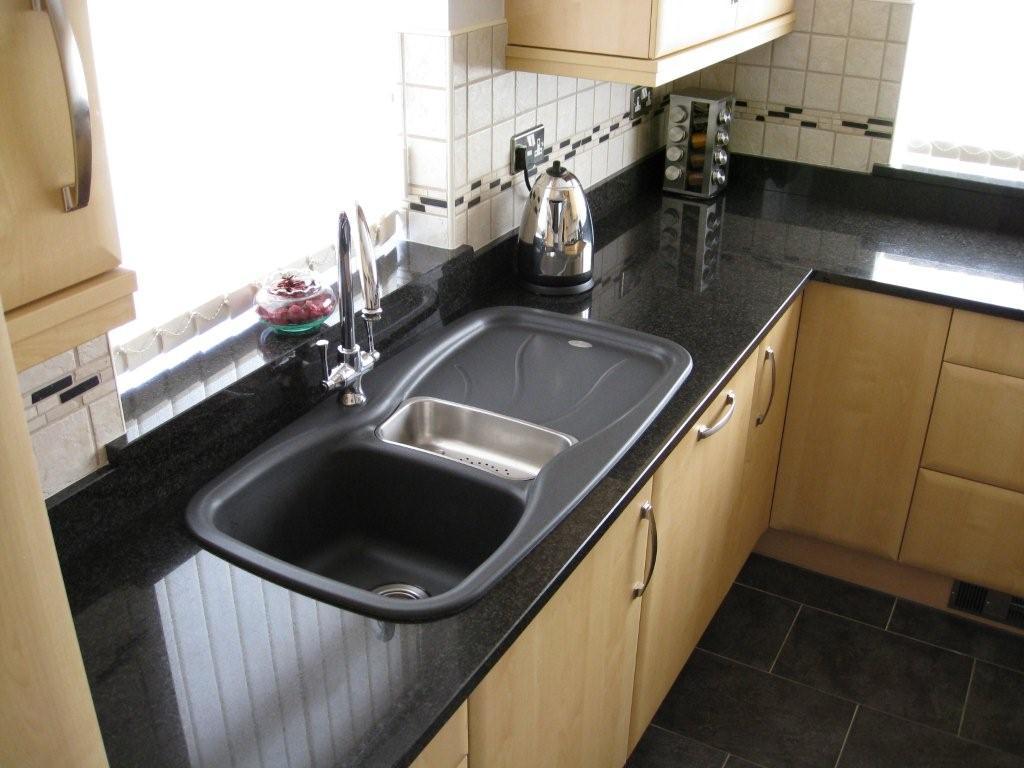 An overmount sink - granite countertop - stonegate